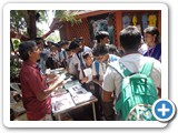 Mr. D. Siva Arun, Programme Assistant issuing Pamphlet to School students